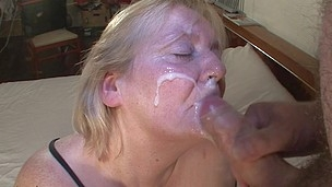 This large mama gets her face overspread in cum