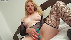 Horny golden-haired housewife playing with her twat