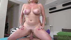 Blonde with big natural jugs is riding on his strong dick