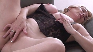 Blond housewife masturbating on the couch