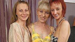 Three older lesbian babes party on the couch