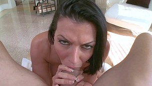 Pierced girl with black hair is frigging her shaved slit